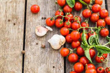 Fresh cherry tomatoes on a wooden table.