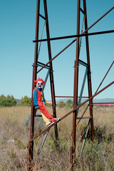 scary clown on an abandoned billboard.