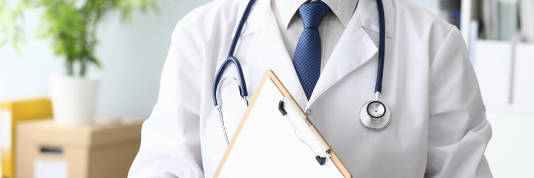 Doctor holding medical clipboard