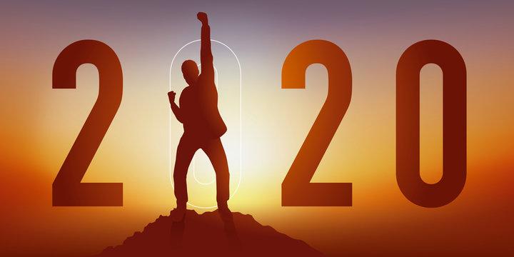 Carte de voeux 2020 montrant un homme satisfait en levant le poing en signe de la victoire après avoir atteint son objectif en arrivant au sommet d'une montagne.