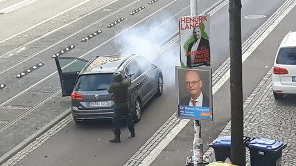 A screen grab taken from amateur video shows shooting in Halle