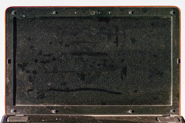 Dirty dusty laptop screen in the office
