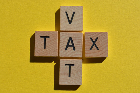 VAT and Tax in a crossword on yellow