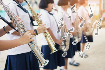Music notes and symbols,Young student Musician playing the Saxophone with Music practice of Band, Musical concept