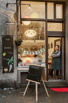 Cafe owner in doorway