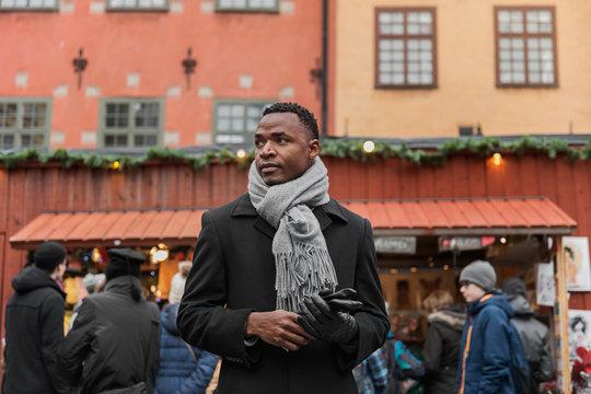 Young man at winter market
