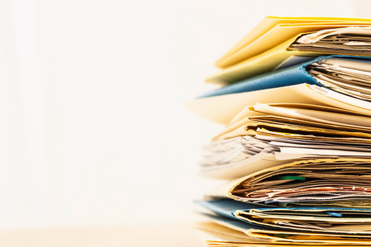 Stack of Files and Papers to Process.