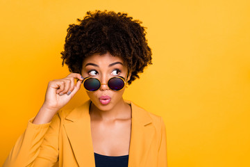 Close-up portrait of her she nice-looking attractive lovely wondered wavy-haired girl touching specs looking aside isolated over bright vivid shine vibrant yellow color background