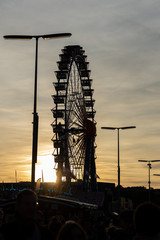 biggest portable ferris wheel of the world in the sunset at the Oktoberfest