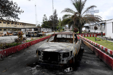A car burned on September's riot is pictured at the office of Jayawijaya's regent in Wamena