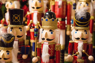 group of wooden Christmas soldiers nutcrackers with different headdresses