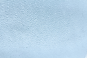 Drops of condensate on the surface of a plastic bottle, close-up