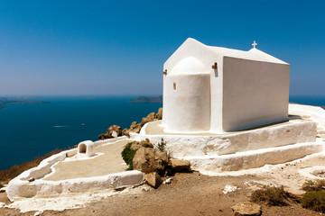 The little white church on Santorini's island in Greece