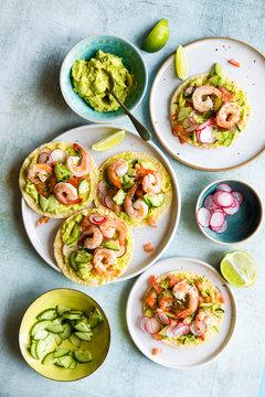 Overhead view of shrimp tostada with guacamole