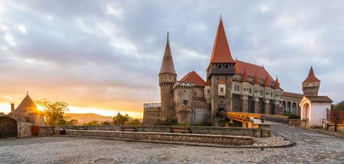 Wall Mural - Landscape with Hunyad Corvin medieval castle in the sunrise light, Hunedoara town,Transylvania landamark, Romania,Europe