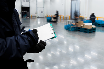 Hand of worker with clipboard checking ready meals goods in the warehouse., Import and export management system for customer service concept. Wall mural