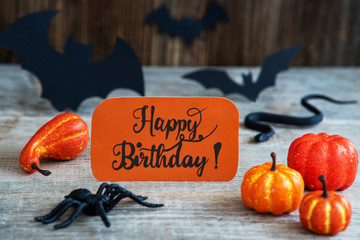 Orange Label With English Calligraphy Happy Birthday. Scary Halloween Decoration Like Bat, Snake And Spider
