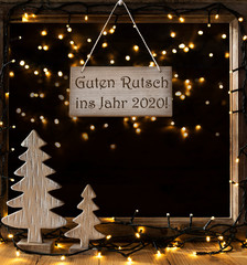 Sign With German Text Guten Rutsch Ins Jahr 2018 Means Happy New Year 2018. Window Frame With Lights In The Night In Background. Christmas Decoration Like Christmas Tree And Fairy Lights.