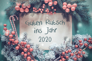 Brown Paper With German Text Guten Rutsch Ins Jahr 2020 Means Happy New Year 2020. Christmas Garland With Fir Tree Branch And Red Decoration. Green Background With Candy Sticks And Snowflakes