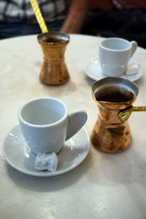 Greek coffee served with traditional greek coffee pots (Briki) and sweet loukoumi. Taken in Athens