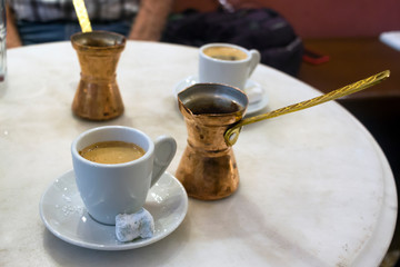 Traditional greek coffee served with brass pot and sweet loukoumi. Taken in Athens