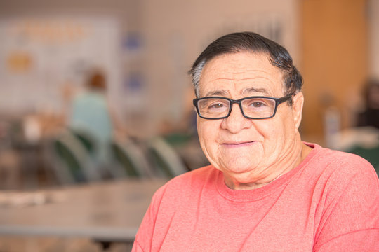 Smiling Hispanic Man in a Senior Center