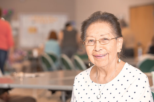 Smiling Hispanic Woman in a Senior Center