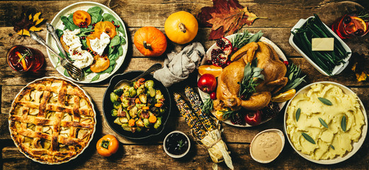 Selection of traditional thanksgiving food - turkey, mashed patatoes, green beans, apple pie on rustic background