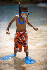 Boy wearing snorkel, mask and flippers