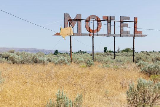 Vintage motel sign with dry scrub-land in foreground, Whitman County, Palouse, Washington, USA.