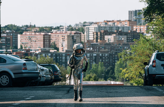 Boy dressed as an astronaut walking on a street in the city