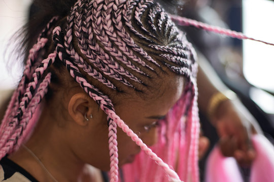 Close up of young woman with pink braids