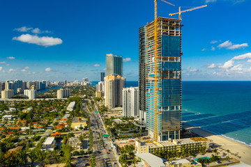 Wall Mural - Aerial photo of the near complete Turnberry Ocean Club Residences and Porsche Design Towers Sunny Isles Beach FL Miami Dade