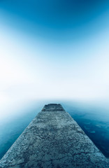 Perspective Cement pier with beautiful sea nature background. Abstract long exposure photography gradient wallpaper advertise. Concept desktop relax