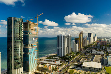 Wall Mural - Aerial photo Porsche Design Tower and Turnberry Ocean Club luxury highrise condominiums on the beach