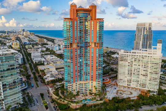 Aerial photo pink Portofino Tower Miami Beach iconic architecture adjacent to South Pointe Park