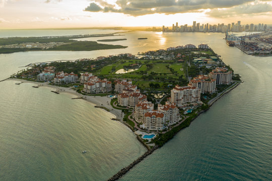 Aerial photo Miami Beach Fisher Island at sunset beautiful South Florida scene