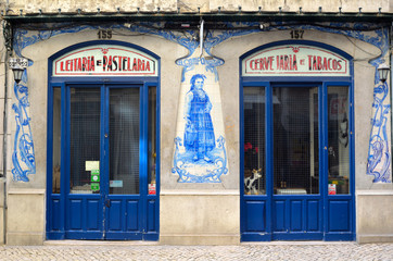 Old traditional store front with ceramic tiles in Lisbon Portugal.