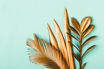 Natural Creative layout made of tropical leaves in golden colors. Minimal surrealism background