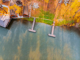 aerial view of autumn forest park near lake with piers
