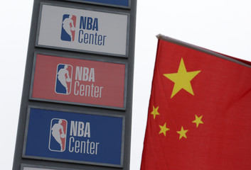 NBA logos are seen next to a Chinese national flag outside a NBA-themed lifestyle complex on the outskirts of Tianjin
