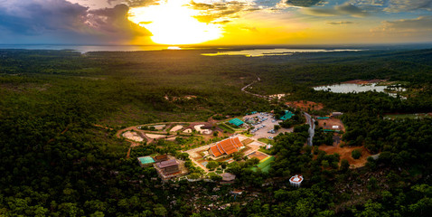 op view Aerial photo from flying drone.Amazing Sirindhorn Wararam Phu Prao Temple (Wat Phu Prao), Sirindhorn - tree shaped fluorescence art temple in Thailand.Photo by select focus.