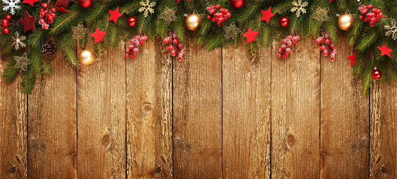 Christmas wooden banner with decoration and fir tree. View with copy space.
