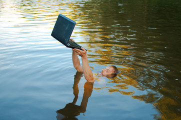man drowns in a lake, but tries to save his laptop-it's probably a computer addiction Fototapete