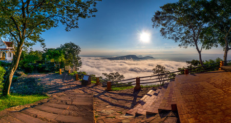 Foto op Plexiglas Bruin Clouds and fog above mountain, beautiful morning sunshine landscape at Pha Mo i Daeng Phra Wihan National Park. Sisaket province,Thailand,ASIA.