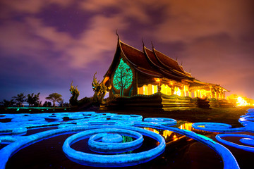 Fotobehang Bedehuis Amazing Temple Sirindhorn Wararam Phuproud in Ubon Ratchathani Province at twilight time,Thailand.Thai temple with grain and select white balance.Night sky effect for Long exposure photo taken.