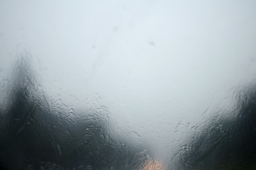 wet windshield of the car, which in a heavy downpour rides on the road with poor visibility. caution, emergency situation