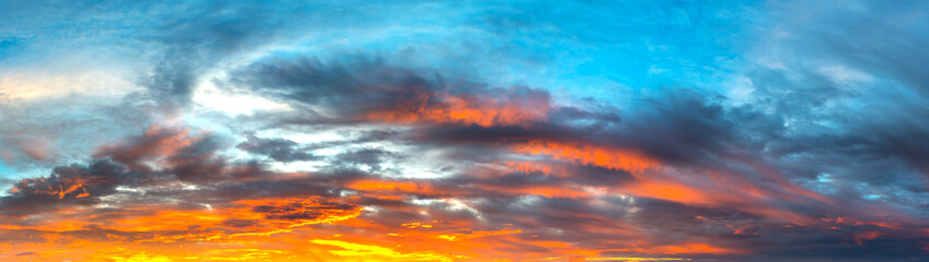 Panorama Sunlight with dramatic sky. Cumulus sunset clouds with sun setting down on dark...