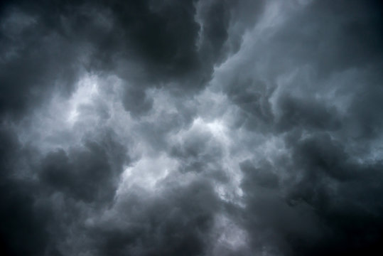 Dark sky and dramatic black cloud before rain.A tropical cyclone is a rapidly rotating storm system characterized by a low-pressure center, a closed low-level atmospheric circulation, strong winds.