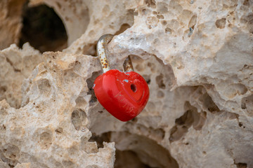 The newlyweds attached a red lock on the bridge of lovers. Cyprus.